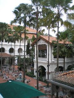 Raffles Hotel, Singapore Red & White with green.  luxury hotels, expensive hotels, travel