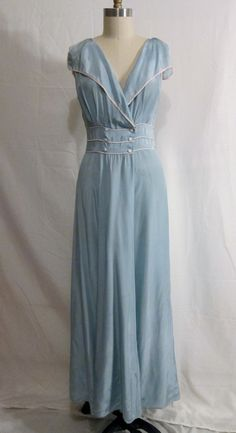 this is a 1940s nightgown! those were the days... when women didn't sleep in a hanes t shirt with emergency pj-pants on the floor beside the bed. Is it just me?? These ladies probably woke up with their hair done and make up right where they put it the day before. I love it.