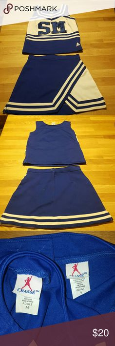 """Cheerleading Costume Great condition! Perfect for Halloween!  Royal Blue and White  Top has a hidden side zipper. Skirt has zipper and button in back.   Includes blue spanx!  Top is an """"adult M."""" Fits more like a small. Skirt is an """"adult 4"""" Chasse Other                                                                                                                                                                                 Mais"""