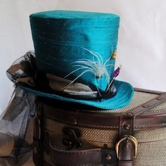 Steampunk Top hat in Teal blue with a touch of feathers - Absolutely beautiful…