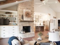Off-center vaulted ceiling and fireplace; also good treatment of ...