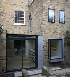 Slim framed sliding glass doors, a structural glass window seat and flush glazed windows. All combined on one rear elevation in London Glass Extension, London House, Glass Roof, House Extensions, Build Your Dream Home, New Home Designs, Big Houses, Cladding, Building Design