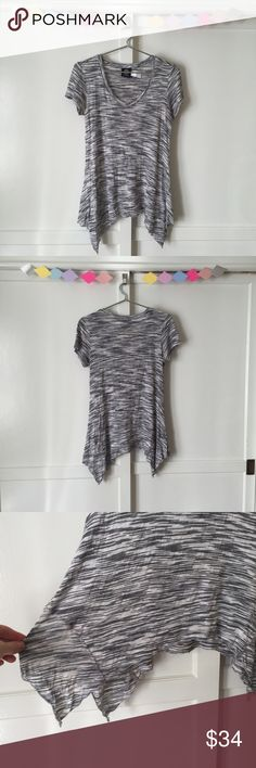 🆕 Bobeau Asymmetrical Striped Top A flowy white shirt with thin black stripes throughout. Asymmetrical hem, v-neck design, & short sleeves. Has some stretch so it's soft and comfortable. Made in 🇺🇸. bobeau Tops Tees - Short Sleeve
