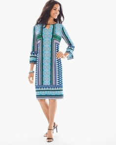 """This dress, in a relaxed silhouette with a keyhole neck detail and fluted cuffs, features a medley of vibrant patterns that work together très chicly.    Length: 39"""".  Polyester, spandex.  Machine wash. Imported."""
