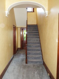 The day we took ownership of the home,looking inside from the front door. Yellow Porters Paints French wash on the walls