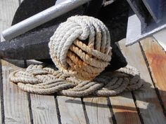 The monkey fist knot originally began as a frequently used sailor term. Also called a sailor's knot it was used to pass lines from a ship to shore or from one ship to another ship. The monkey's fist was used at the end of a line to add weight. Generally a bolt, rock or other heavy object would be placed inside the knot to add weight before tightening the knot.