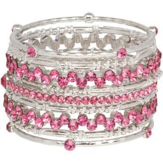 "Sparkling Bangle Stack of 9 Silver Tone and Pink Crystal Bracelets Heirloom Finds. $19.99. Create several trendy styles with this set of 9 stacking bracelets! Wear one, some or all!. Vivid pops of color with pink crystals. Makes a great gift - arrives gift boxed!. Fashion forward with this fun style!. Bracelets are 8"" around with a 2"" total width"