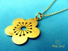 Silver flower necklace gold washed.