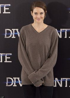 Drab: Shailene Woodley dressed down in a brown jumper and black trousers combination for the Divergent photocall in Madrid