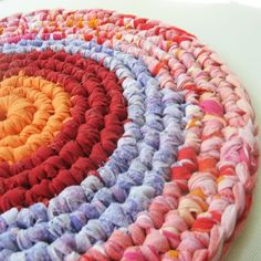 OK, this is not made of plastic, but it is made of upcycled linens. And it's so beautiful! Large Upcycled Rag Table Coaster or Mat. $30.00, via Etsy.
