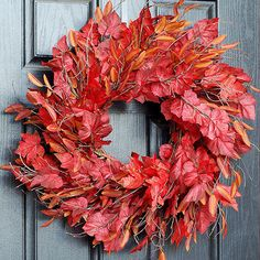 Vivid faux foliage and slender branches combine for a lush door display. But there's a secret to this wreath's exceptionally full appearance: It's two wreaths in one!