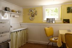 The stove was already there, the sink was found in a neighbor's yard, and the 1950s chairs and tables were inherited with the camp. From the bold yellow fabric of the furniture, Surratt built outward.