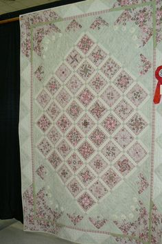 Pale pink and white..pretty quilt...could never get away with pink in my house full of guys, but love this pattern.