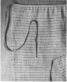"""Fig. 61 """"Rural PA Clothing"""" p. 61. Linen apron in small blue & white checks. 41"""" L x 39 3/4"""" W (selvage edges).  """"The red, white, & blue linen tape is inserted through a narrow casing enabling the wearer to adjust the fullness to her physical needs. The red cotton cross stitch initials """"S.K."""" to the right of the apron string are those of Susanna Kriebel of Montgomery County (PA) who wore this apron.""""  Schwenkfelder Museum."""