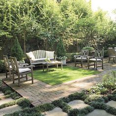 """Formal sitting area softened by grass """"rug"""" outlined in brick + softened again w/ stones set in dwarf mondo grass. Backdrop of crape myrtles (looks like) Formal but gives order to small area. Outdoor Dining Room Ideas - Southern Living"""