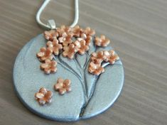 Polymer silver pendant necklace with rose gold spring/summer flowers