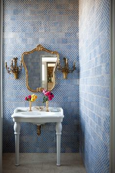 interior design White pedestal sink contrast beautifully against a blue tile floor to ceiling wall treatment.  Love the one-of-a-kind mirror and lighting.  Gorgeous contrast and classic color combination of blue and white.  #froghilldesigns blog #walltile