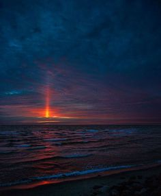 A natural phenomenon referred to as a solar pillar--these vertical beams of light are usually created in cold air by ice crystals falling from high clouds. Credit: Lars D. Terkelsen.