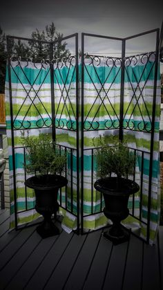 Privacy screen made from metal corner supports from a cheap gazebo and shower curtains.