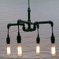 Industrial - Steampunk Black Malleable Iron Chandelier Milton Douglas Lamp Co. An industrial-chic malleable iron chandelie… Pipe Lighting, Rustic Lighting, Vintage Lighting, Cool Lighting, Chandelier Lighting, Lighting Ideas, Pendant Lights, Industrial Chandelier, Industrial Pipe