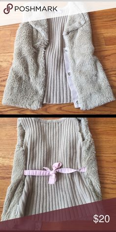 Calvin Klein fur vest with pink back tie Adorable taupe fur vest which has a pink tie in back. This is a staple piece for any little girls closet!! My daughter wore this with her ruffle tops/pants and with jeans. Adorable piece!! Size 6 Calvin Klein Shirts & Tops