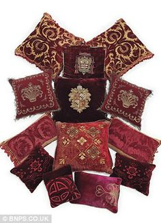 A group of thirteen crimson velvet cushions, collected by Kennedy throughout her life and on sale as a set