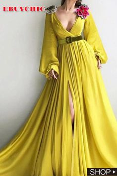 Details - Lemon dress color - Silk dress fabric - Embroidered flowers on shoulders and a green velvet belt - A-line dress with long sleeves, V-neck and waist definition and an open leg - For parties and special events Hijab Evening Dress, Evening Dresses, Lemon Colour Dress, Satin Dresses, Silk Dress, Mode Shop, Yellow Fashion, Classy Outfits, Dress To Impress