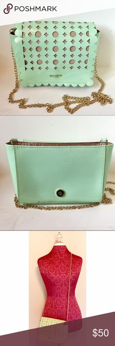 Spartina Seafoam PatentLeather Crossbody In great shape! Small flaw as shown in picture, but not visible when the purse is closed. The cutouts are so in style right now and the Cross-body style is so convenient. Inside has a few small pockets. Closes with a magnetic button. No trades or low balls. Please use the offer button. Spartina 449 Bags Crossbody Bags