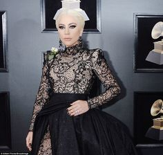 Rock chic: The Million Reasons singer rocked sparkling eye shadow with kohl lined lids, pi...