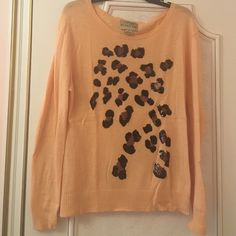 White label Wildfox cheetah sequined This sweater is super cute it has sequins and cheetah print there is some minor polling on the sleeve it is 100% authentic bought from asks off fifth but the label is upside down for some reason Wildfox Sweaters Crew & Scoop Necks
