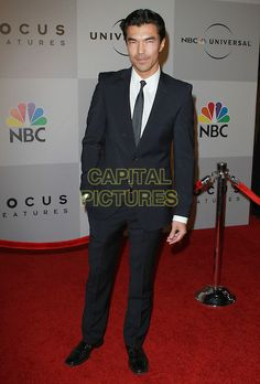 IAN ANTHONY DALE .NBC Universal 68th Annual Golden Globe Awards After Party held at the Beverly Hilton, Beverly Hills, California, USA..January 16th, 2011.full length black suit hand in pocket .CAP/ADM/KB.©Kevan Brooks/AdMedia/Capital Pictures.