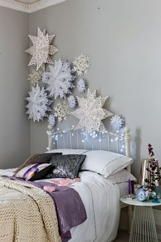 Cluster oversized paper snowflakes for a beautifully wintry bedroom wall. You could also suspend them from the ceiling.