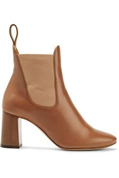 Chloé's timeless ankle boots are crafted from supple tan leather. Designed with elasticated panels and a pull tab, this pair slips on effortlessly. The architectural wooden heel gives them a modern feel.