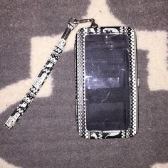 Black&White elephant iPhone 5 wallet case!! Amazing condition, black and white elephant tribal print iPhone 5 wallet case with silver accents, not urban outfitters just posting for views Urban Outfitters Bags Clutches & Wristlets