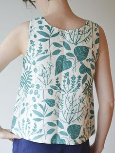 Beautiful all-linen tank top printed with teal green houseplants.