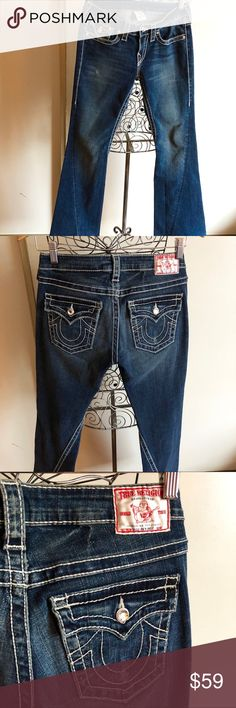 """True Religion Disco Joey Big  T jeans Great condition True Religion jeans.  The style is called  Disco Joey Big  T.  The style is # 10503NBTC.  They are a dark color with thick. They have the white cloth label and clear crystal buttons.   Measurements: Size 28, front rise 7"""", back rise 12"""". Inseam 30"""",  leg opening 9"""". Zip fly with clear crystal  button closure. Five-pocket style.  Materials: 99% cotton, 1% elastine True Religion Jeans Boot Cut"""
