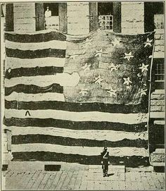 First known photo of the Flag th a t flew over Fort McHenry   1873