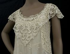 Beautiful custom designed wedding gown made from antique lace elements in the 1970s by the bridal department at Henri Bendel. (front detail)