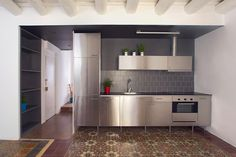 aluminium kitchen with hydraulic tiles