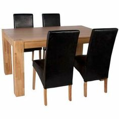 Schreiber Eden 150cm Oak Table and 4 Black Chairs. from Homebase.co.uk