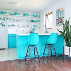 Aqua kitchen with open shelving and turquoise pyrex collection. Spot the case study planter from modernica!