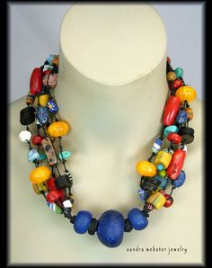 African bead necklace.  ZULU QUEEN - Handmade African Beads Handknotted. Designer is Sandra Webster and website is http://www.bonanza.com/listings/ZULU-QUEEN-Handmade-African-Beads-Handknotted-Nklc/2296726