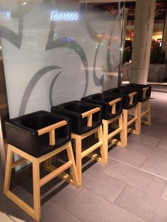 Tavo highchairs on display at the new modern food court in Yorkdale Mall in Toronto. Highchair designed and manufactured by Monte Design - Modern nursery and kids furniture.