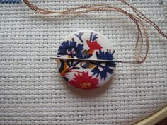 Never lose a needle again! This beautiful purple/red floral needle minder is made with wooden buttons and strong magnets! The back magnet has Needle Minders, Magnets, Strong, Buttons, Purple, Floral, Red, Beautiful, Florals