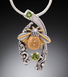 jewelry image of Sterling Silver, 14k Gold Fill, Peridot &  Fossilized Walrus Tusk Necklace  (Size:  1.5 in. tall x .75 in. wide)