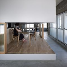 Here is another project by our featured architects Suppose Design Office, this time the renovation of a house in Hiroshima city, Japan, where interiors are divided by walls that only reach halfway down from the ceiling. Called House in Kamiosuga, the project involved gutting the existing interior and inserting new half-height partitions between existing beams. More