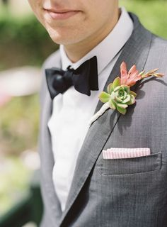 Succulent boutonniere for the groom .