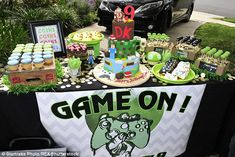 Looks good: The party included an elaborately decorated cake as well as video game themed ...