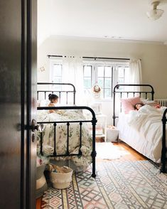 Ava was two when we transitioned her to a big girl bed and she adjusted right away. We're going to test this out with Livy since she turned… Girls Bedroom, Bedroom Decor, Twin Bedroom Ideas, Master Bedroom, Wrought Iron Beds, Shared Rooms, Girls Shared Bedrooms, Kid Bedrooms, Little Girl Rooms