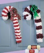 Candy Canes - no crochet required, make bundles of yarn (like pom poms) and attach to wire coat hanger.
